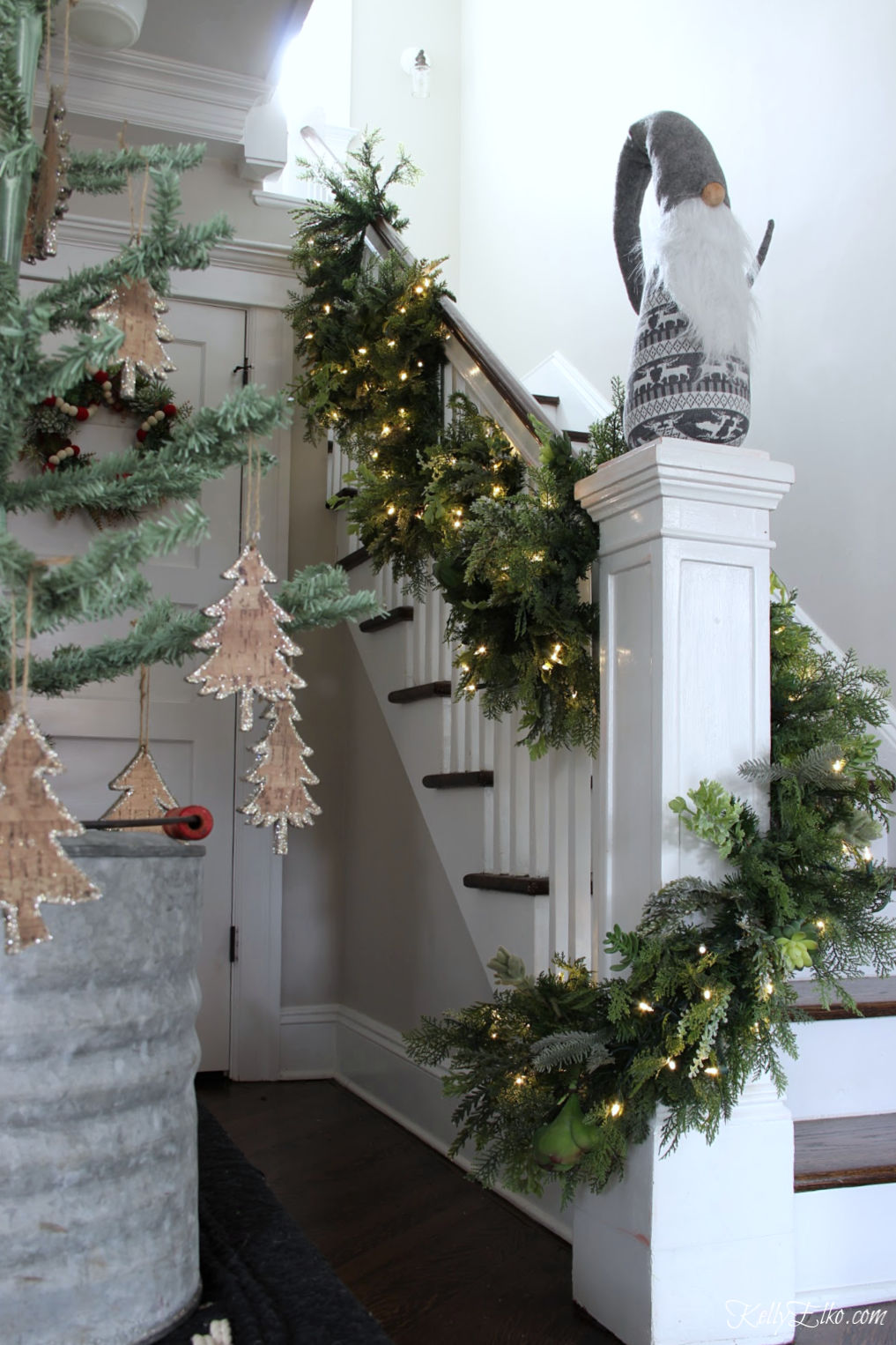Tour this stunning Christmas home - love the lush succulent garland on the banister kellyelko.com #christmas #christmasgarland #christmasstairs #christmasbanister #gnone #christmasdecor #christmashometour