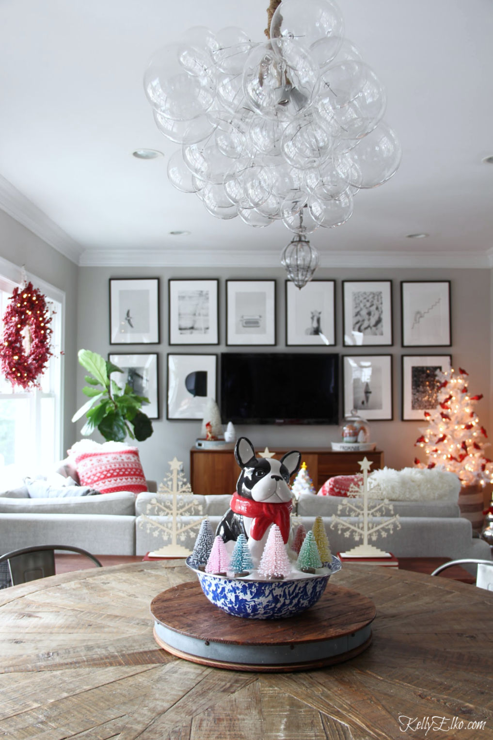 Love this fun Christmas home tour and that beautiful bubble glass chandelier kellyelko.com #lighting #chandelier #christmas #christmascenterpiece #christmasdecor #farmhousechristmas #christmastree