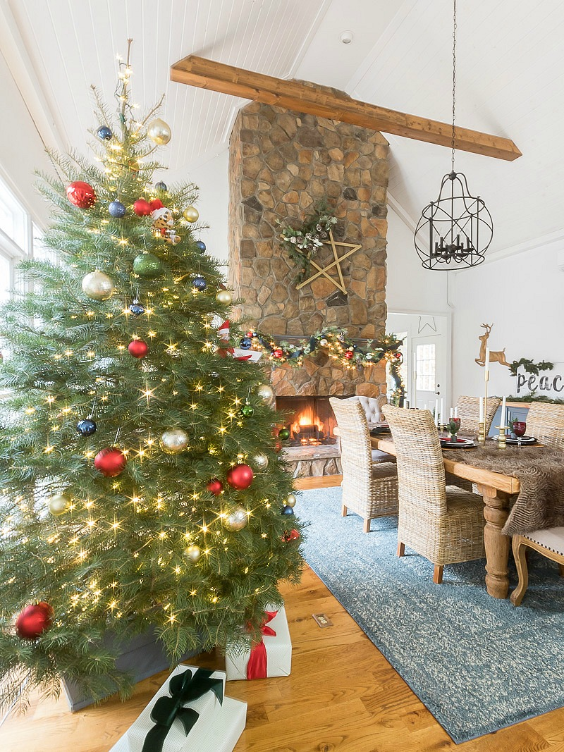 Stunning Christmas dining room with handmade wooden star on mantel