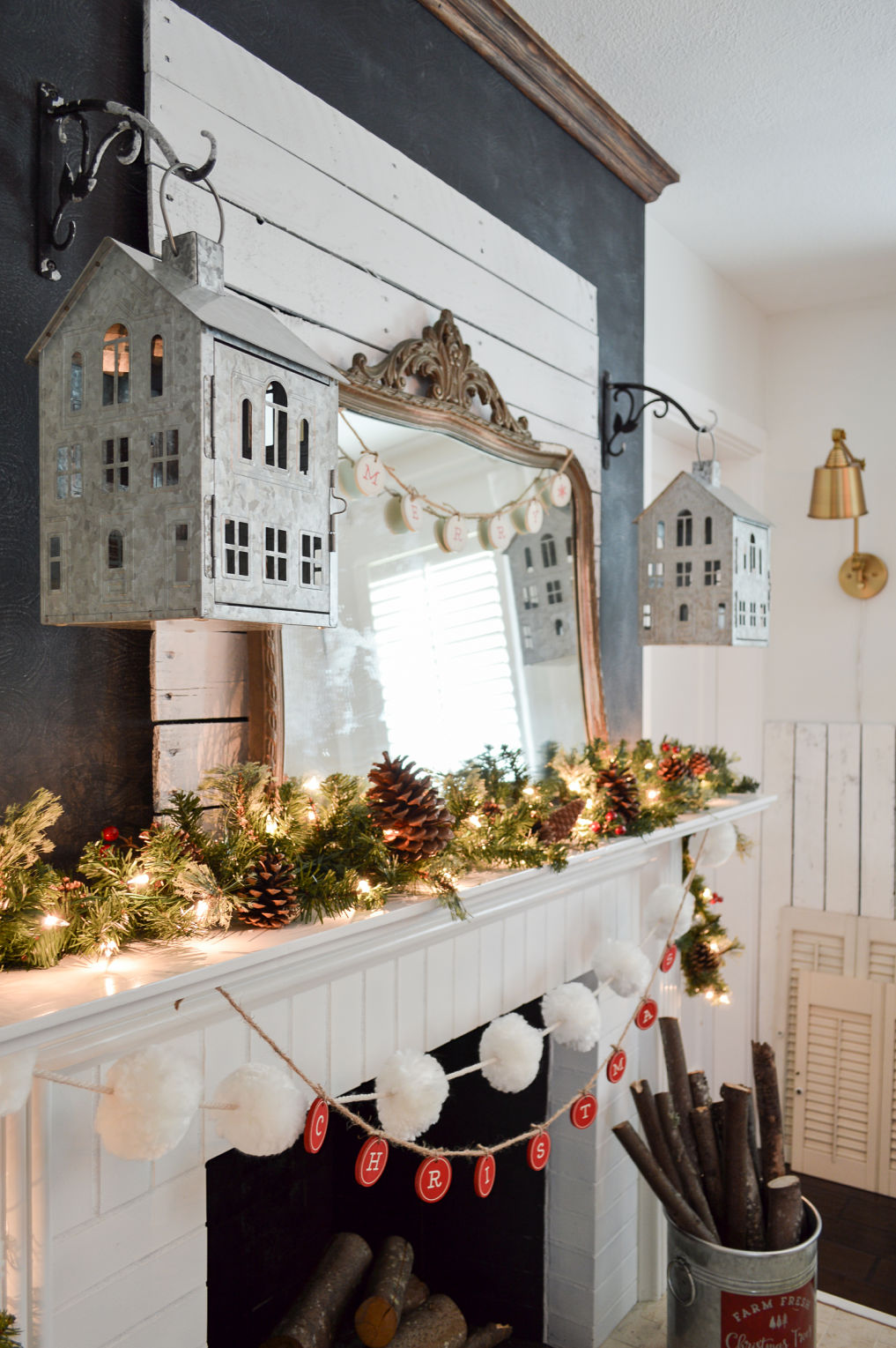 Beautiful Christmas mantel with house lanterns kellyelko.com #christmasdecor #christmasmantel #farmhousechristmas