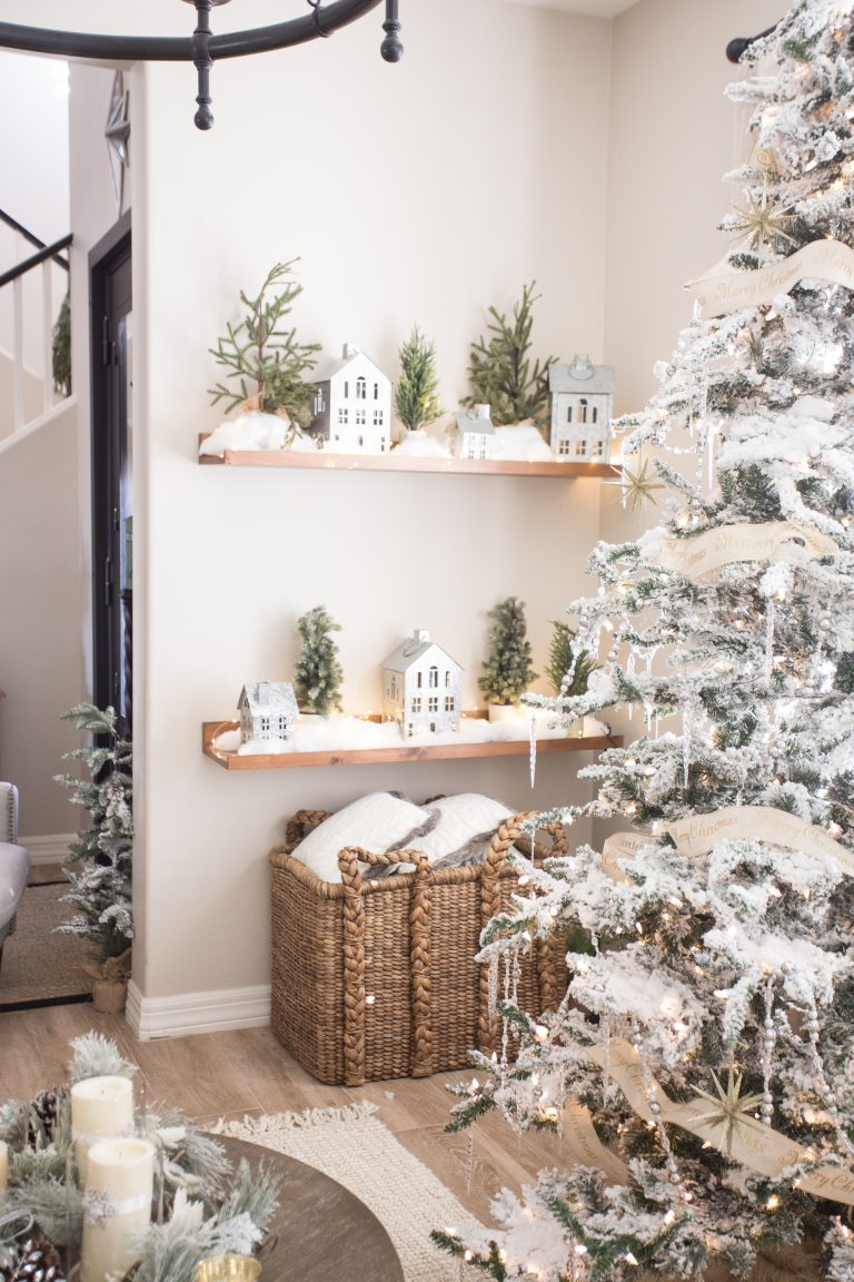 Love this winter village of galvanized little houses kellyelko.com #christmasdecor #neutralchristmas #farmhousechristmas #christmastree #flockedtree #christmasdecorations #neutralchristmas #whitechristmas #kellyelko