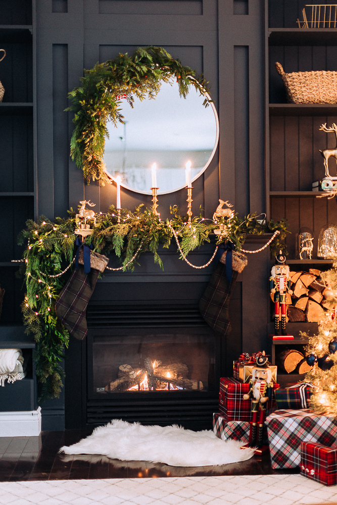 Love how she turned a mirror into a Christmas wreath on this stunning mantel