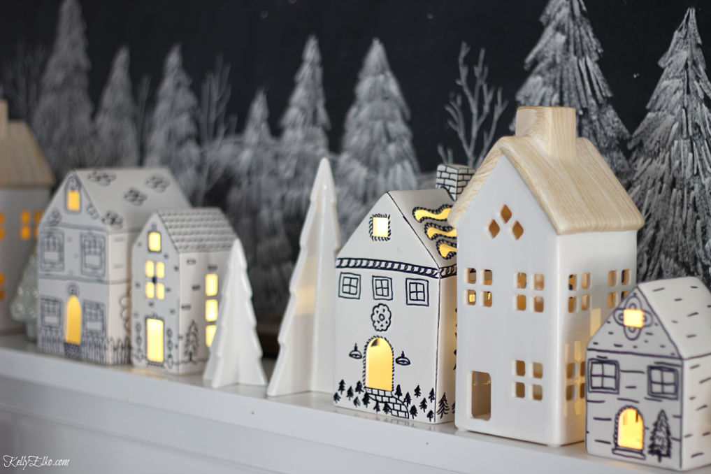Love these little doodled ceramic houses on this Christmas mantel kellyelko.com #christmasdecor #diychristmas #christmascrafts #sharpiecrafts #christmasmantel #farmhousechristmas