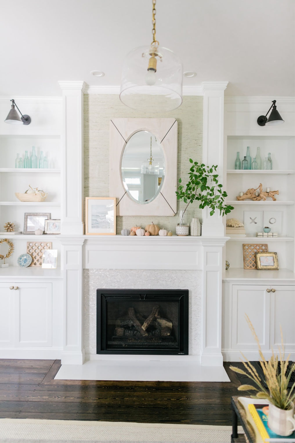 Love this fireplace with white stone tile surround and built in bookshelves kellyelko.com #mantel #manteldecor #fireplace #farmhousestyle