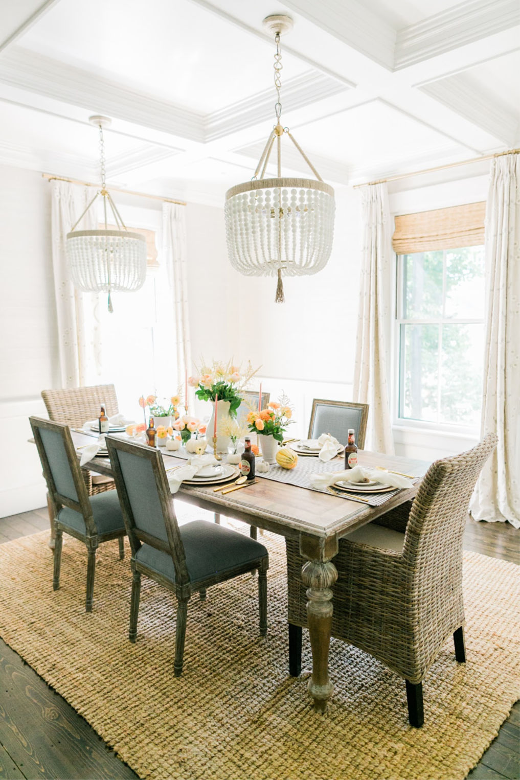 Beautiful dining room with a pair of beaded chandeliers hung from coffered ceiling kellyelko.com #farmhousestyle #farmhousedecor #cottagestyle #neutraldecor #diningroom #diningroomlighting #lighting #diningroomdecor #neutraldecor