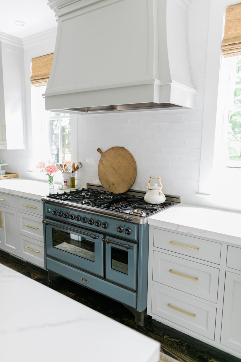 Beautiful white kitchen with Ilve Majestic stove in blue kellyelko.com #kitchen #kitchenoven #vintagekitchen #interiordecorate #interiordesign #kitchenreno #stove