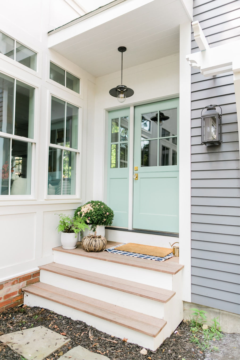 Love this mint green Dutch door kellyelko.com #doors #vintagedoors #porch #porchdecor