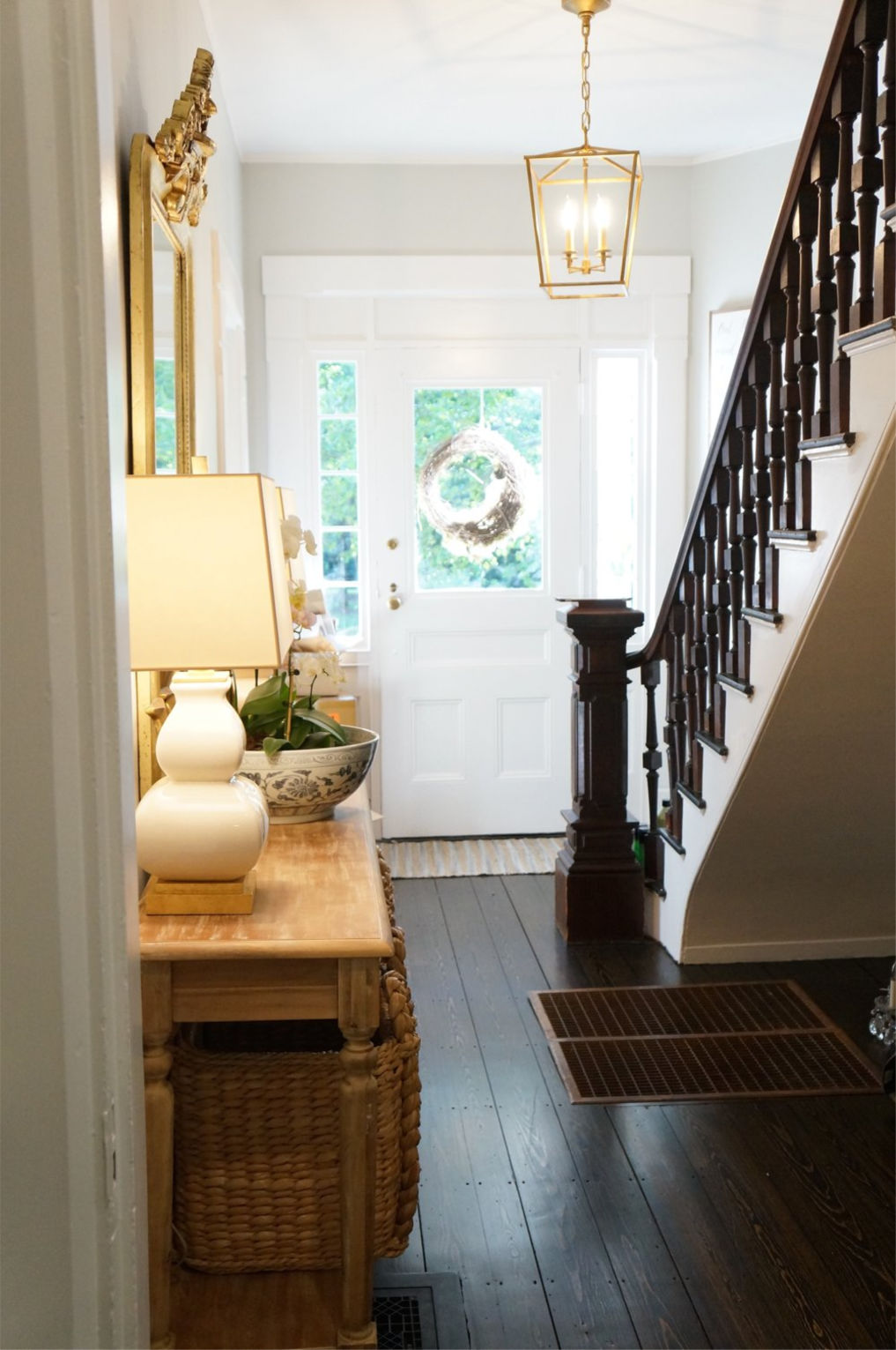 Eclectic Home Tour Finding Lovely - this beautiful old home has been updated but keeps it's charming details like the wood banister and original wood floors kellyelko.com #foyer #entry #oldhome #vintagestyle #vintagedecor #farmhousestyle #farmhouse #interiordecorate #interiordesign