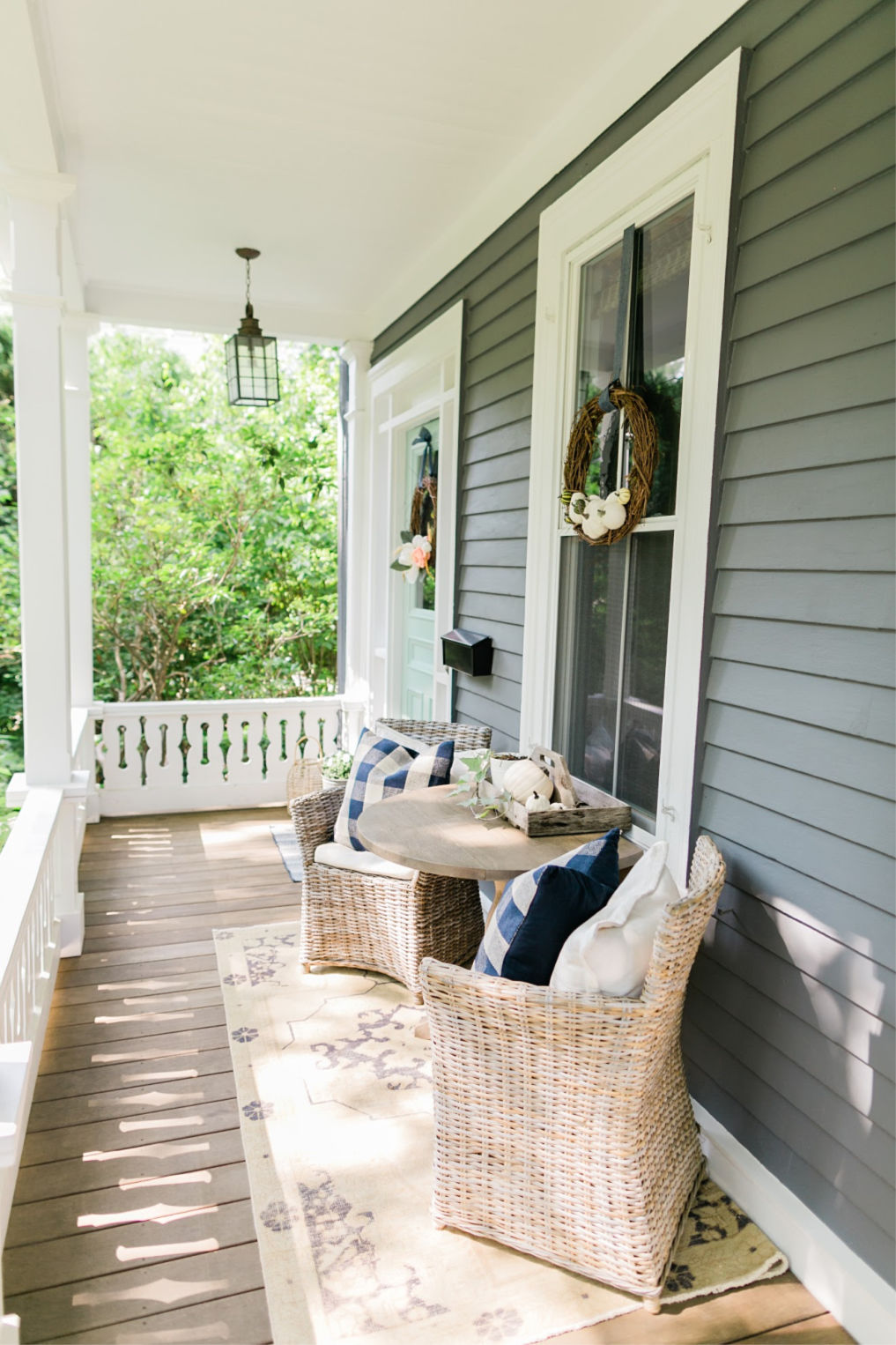 Charming front porch with beautiful cutout railing kellyelko.com #porch #frontporch #oldhome