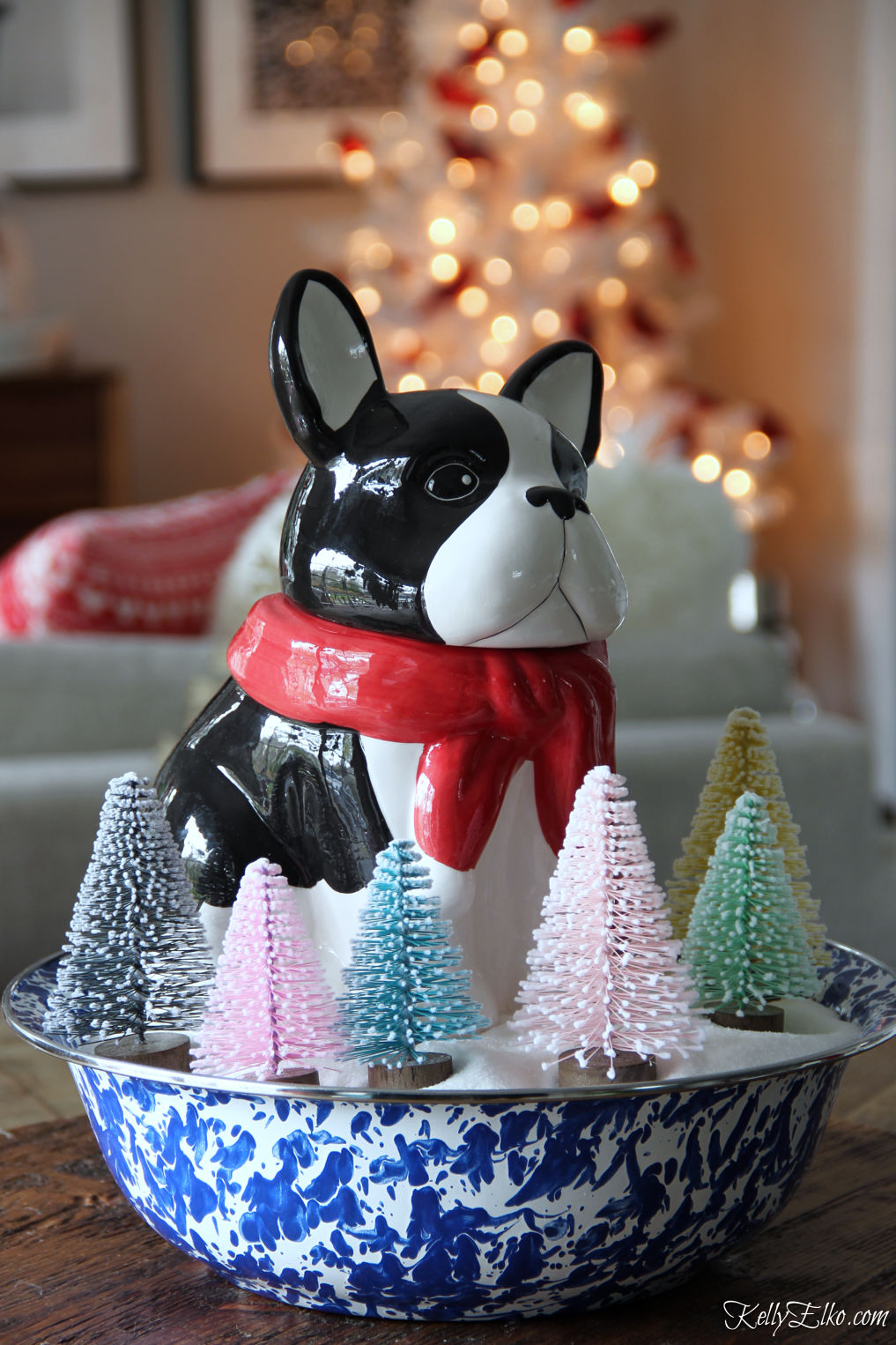 Love this little dog French Bulldog cookie jar surrounded by bottle brush trees for Christmas kellyelko.com #frenchbulldog #christmasdog #christmasdecor #christmascenterpiece #whimsicalchristmas #bottlebrushtrees #vintagechristmas