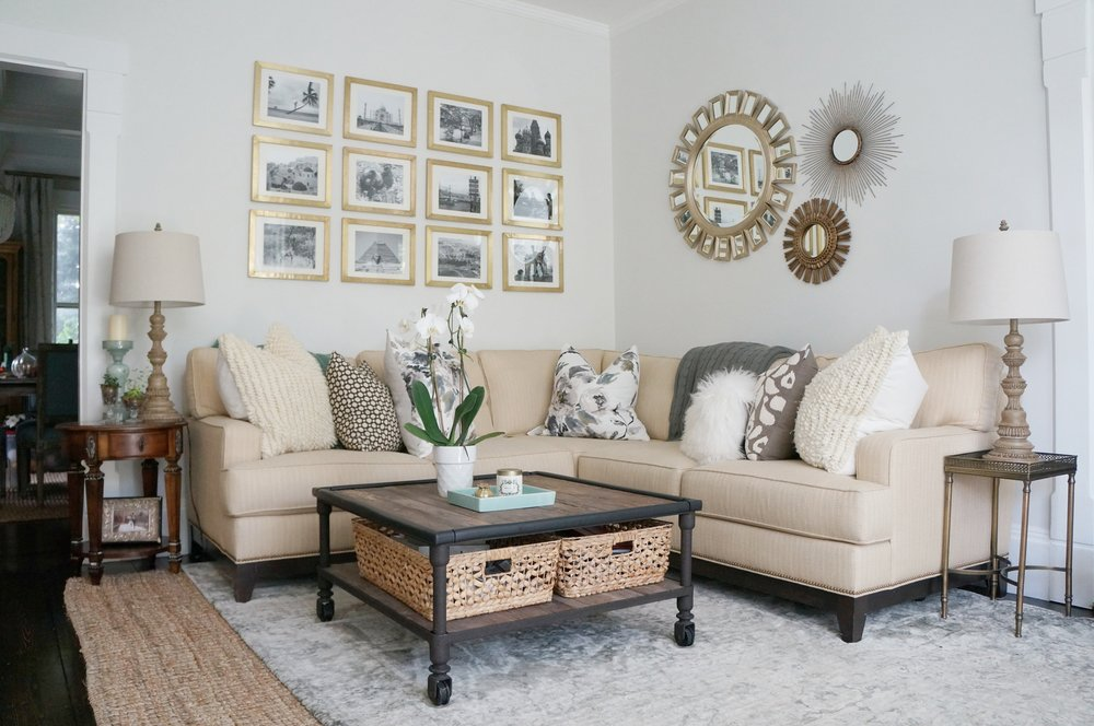 Sectional sofa in a cozy family room and I love the gallery wall of travel photos kellyelko.com #gallerywall #sectionalsofa #familyroom #familyroomdecor #neutraldecor #interiordecor