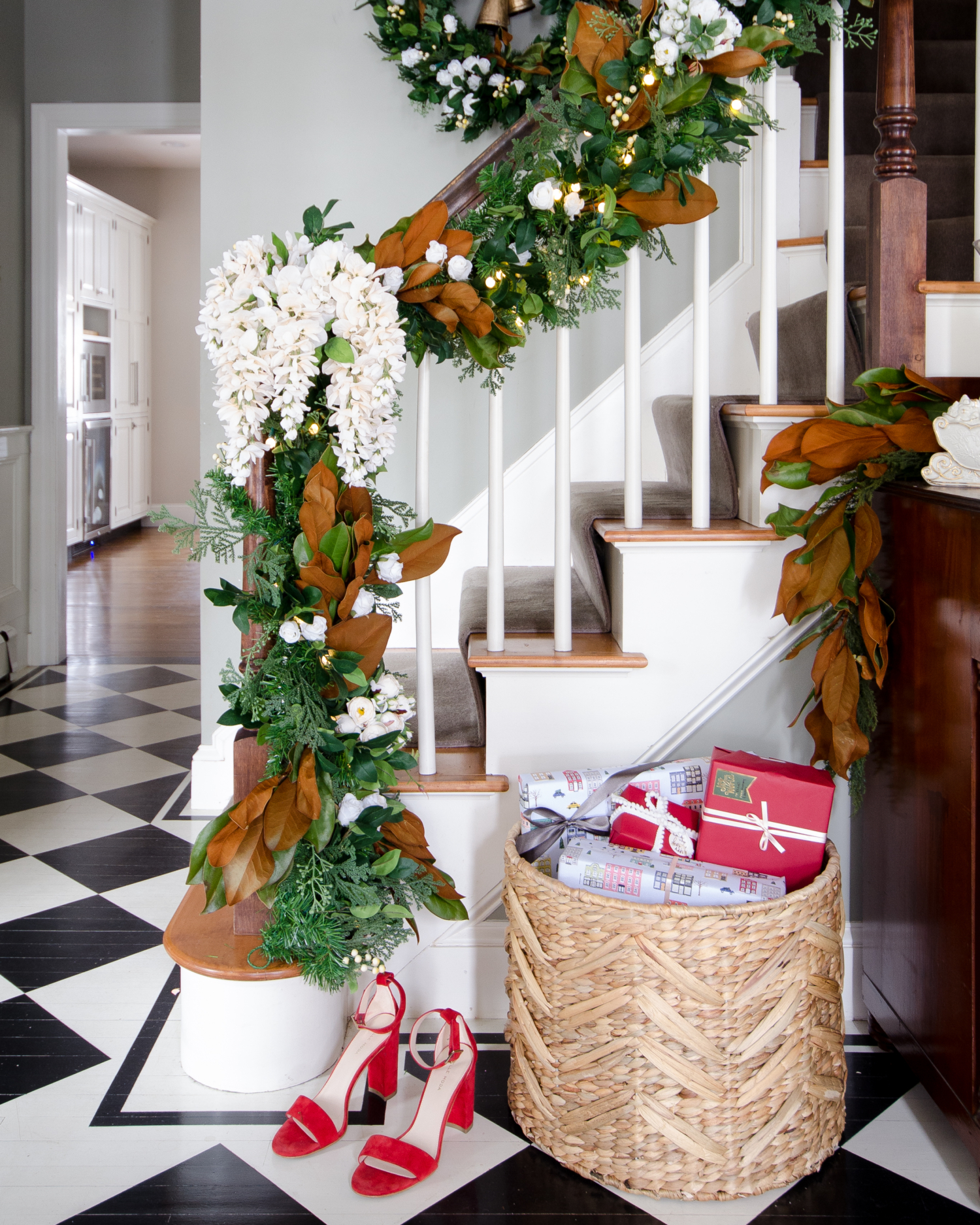 Beautiful banister garland with magnolia leaves and white flowers