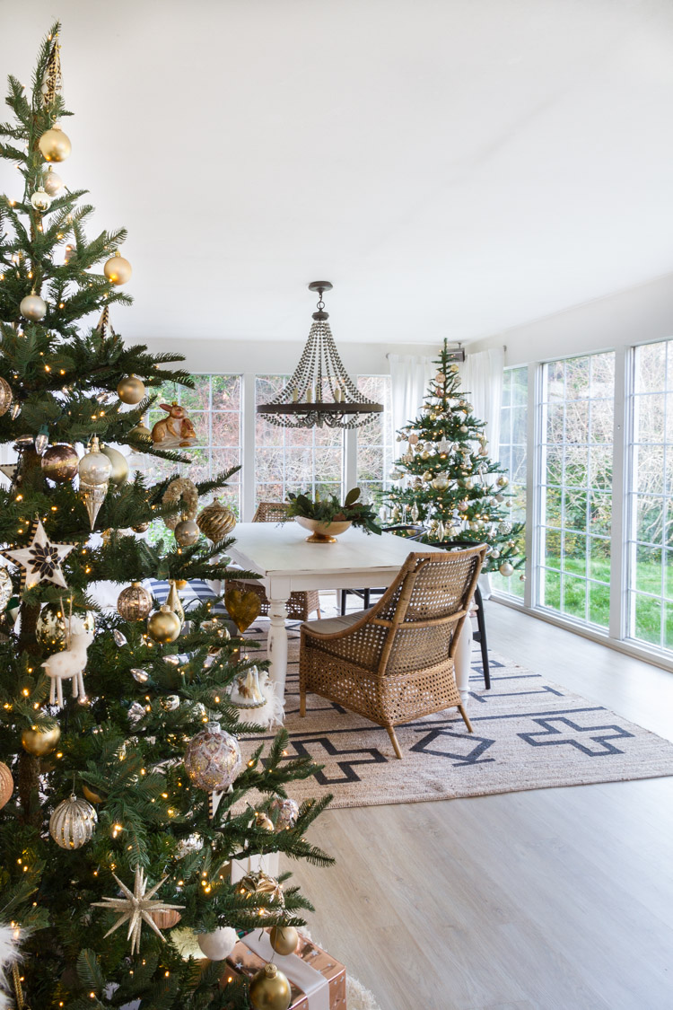 Love this dining room with two Christmas trees
