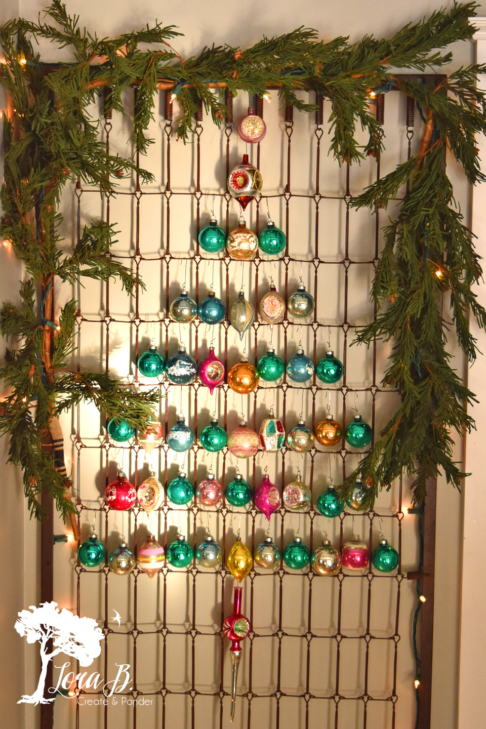Shiny Brite Decorating Ideas - the most creative ideas for displaying Christmas ornaments like this ornament tree hung on an old bedspring kellyelko.com #vintagechristmas #christmasornaments #christmaswreath #christmasdecor #christmasdecorating #shinybrites #vintageornaments #ornaments #christmastree