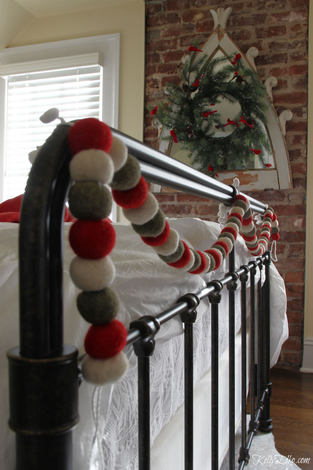 Cozy Christmas Guest Bedroom - love the flannel sheets, fringe throw and other whimsical decorating ideas kellyelko.com #christmas #christmasbedroom #christmasdecor #christmasdecorating #christmasbedding #christmaswreath #vintagechristmas #garland #bedroomfurniture