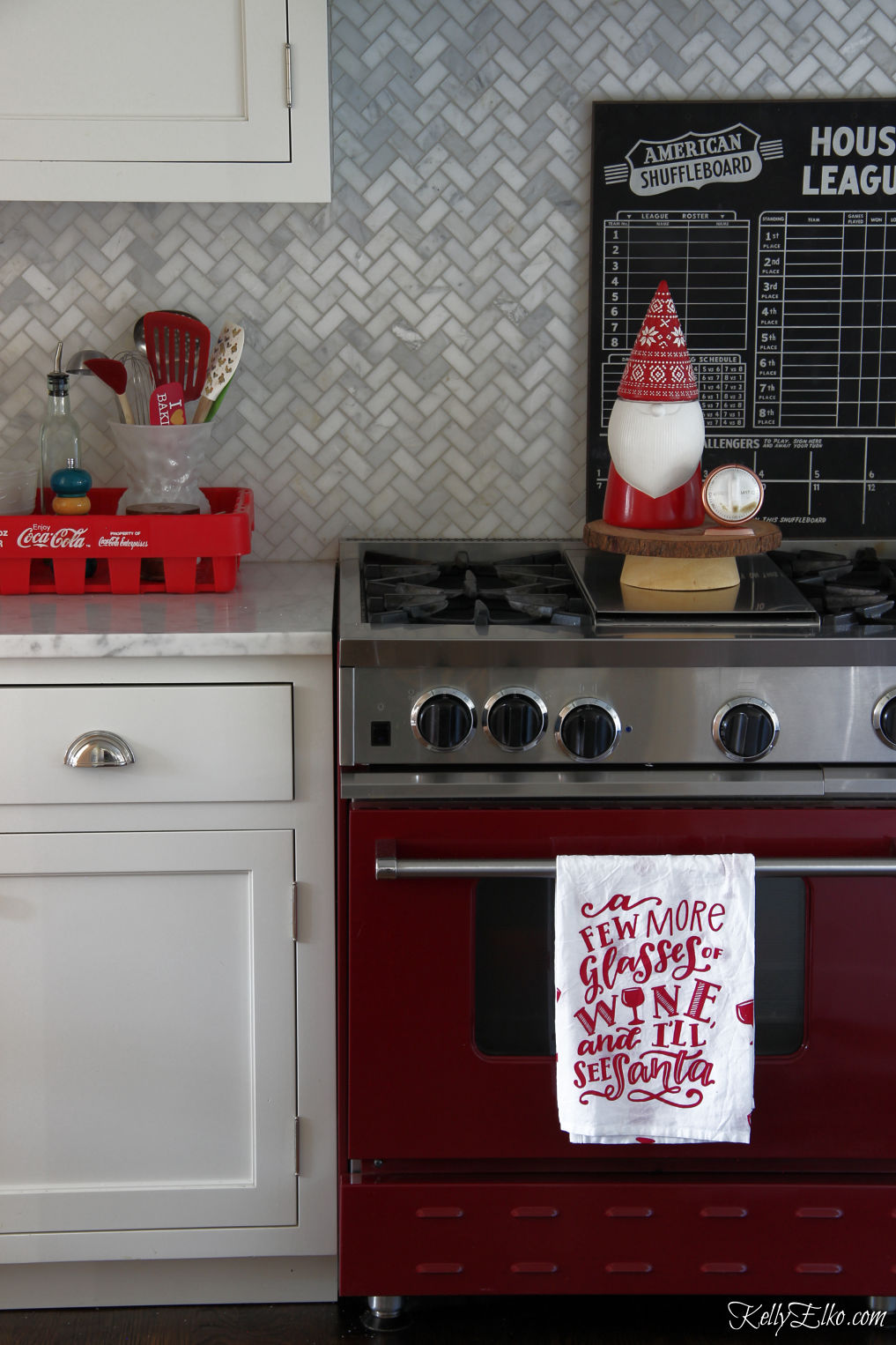 Love this red stove in this Christmas kitchen kellyelko.com #whitekitchen #redstove #christmaskitchen #farmhousechristmas #christmasdecor #gnome #vintagechristmas