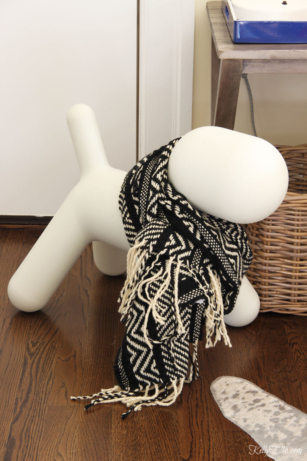How cute is this dog sculpture wearing a cozy winter scarf kellyelko.com #christmas #christmasdecor #christmasdog