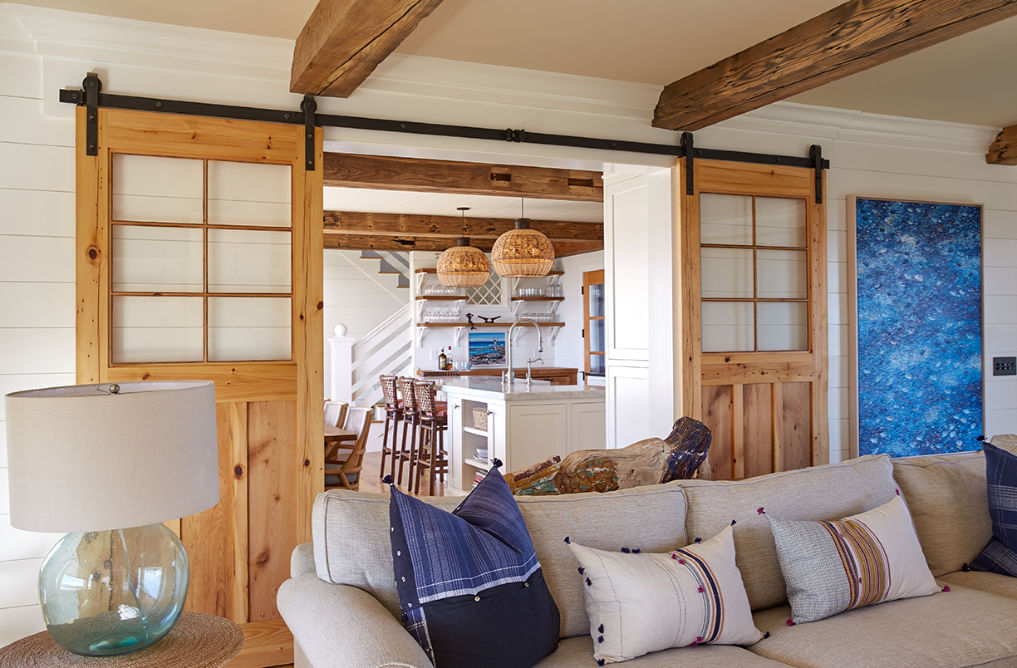 Beautiful farmhouse family room with shiplap walls and sliding barn doors kellyelko.com #farmhousestyle #farmhousedecor #barndoors #familyroom #familyroomdecor #familyroomfurniture #interiordecor #interiordesign