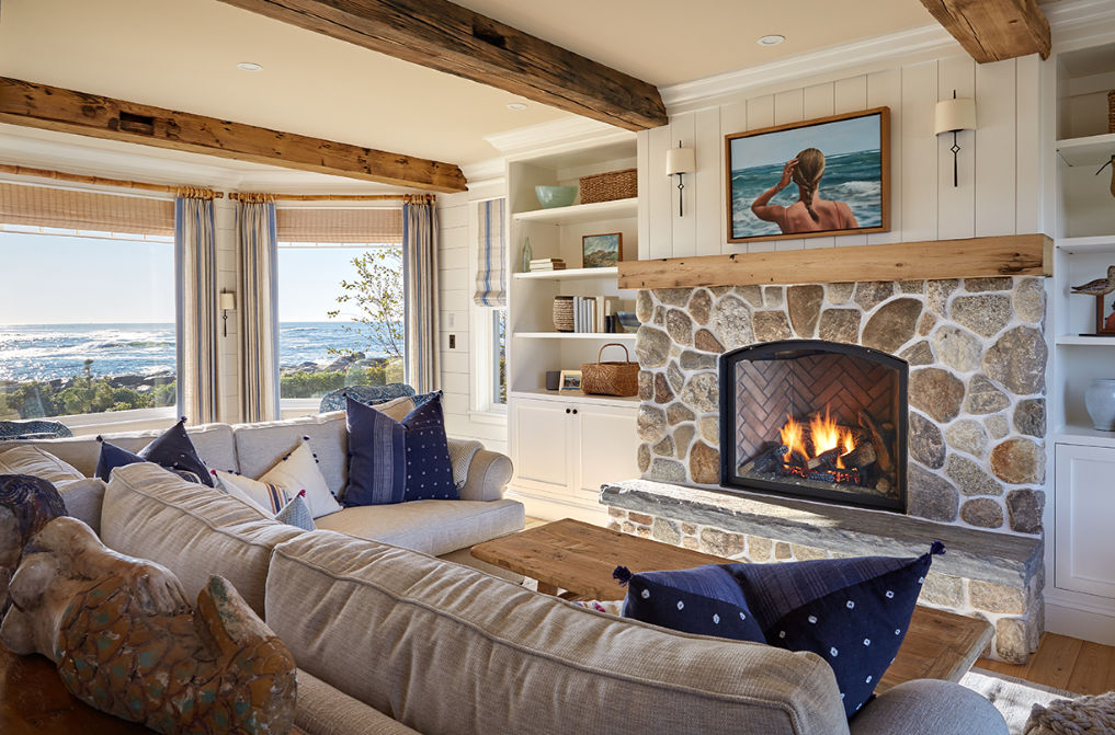 Love this stone fireplace with wood mantel in this beautiful family room kellyelko.com #familyroom #familyroomdecor #livingroom #livingroomdecor #mantel #fireplace #farmhouse #farmhousestyle #interiordecor #interiordecorate #rusticdecor