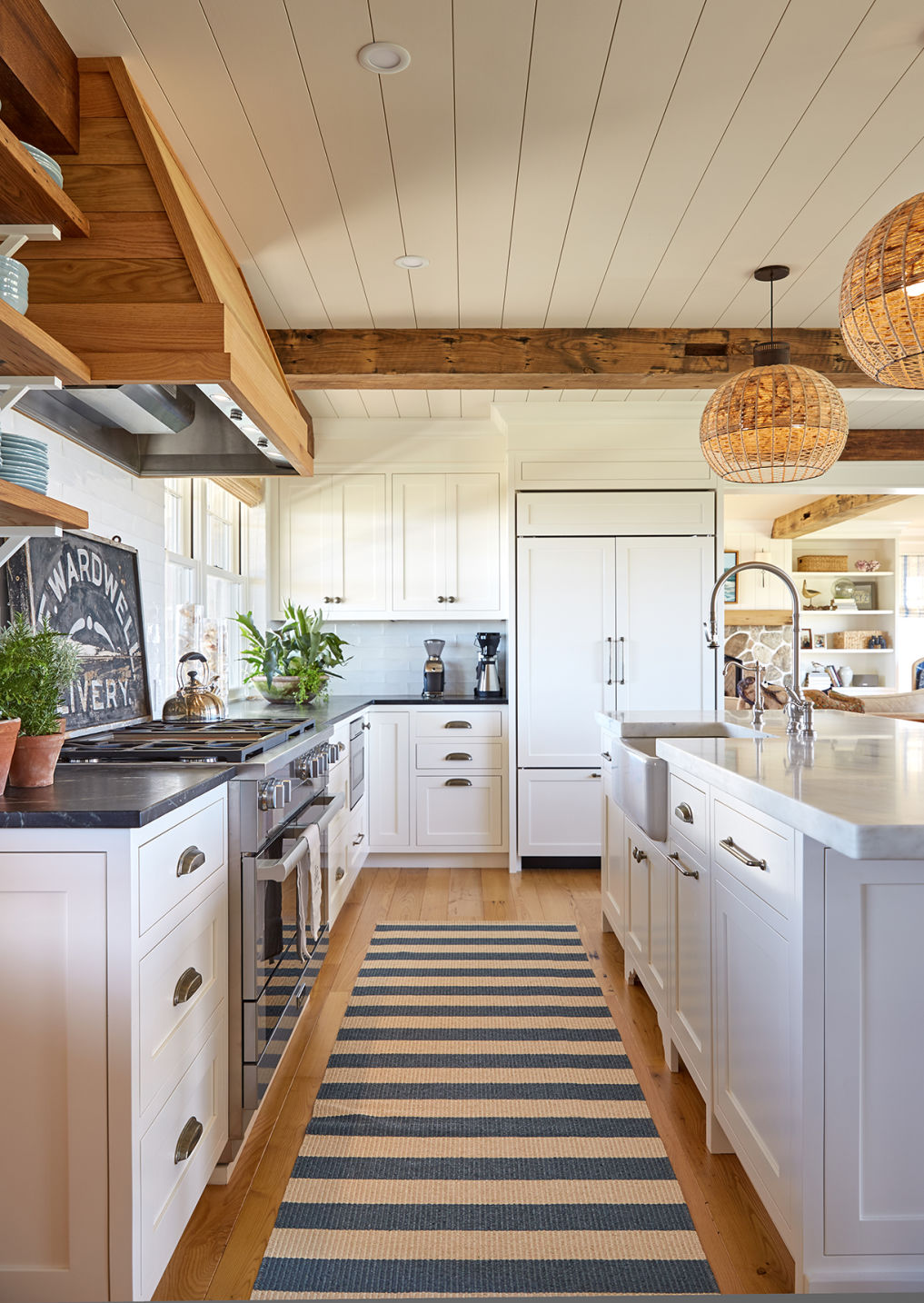 Beautiful white farmhouse kitchen with natural wood accents and open shelves kellyelko.com #kitchen #kitchendesign #kitchendecor #farmhousekitchen #farmhousestyle #whitekitchen