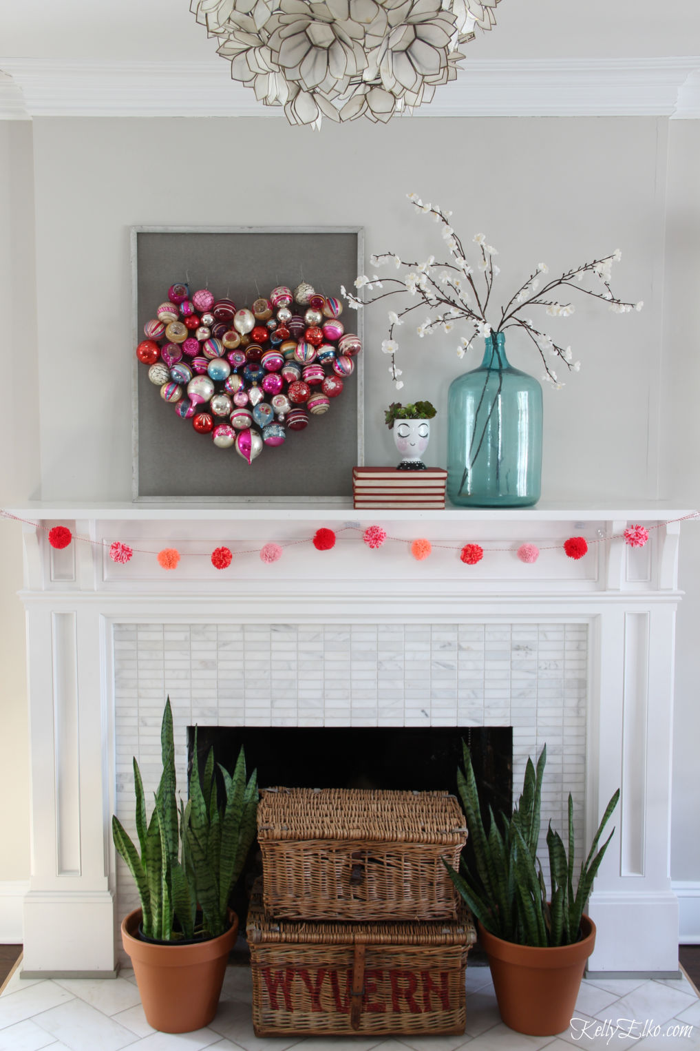 Beautiful spring mantel with a heart made out of vintage Christmas ornaments! kellyelko.com #mantel #manteldecor #springmantel #valentinesday #valentine #valentinesdecor #springdecor #fireplacedecor #shinybrites #christmasornaments #diydecor