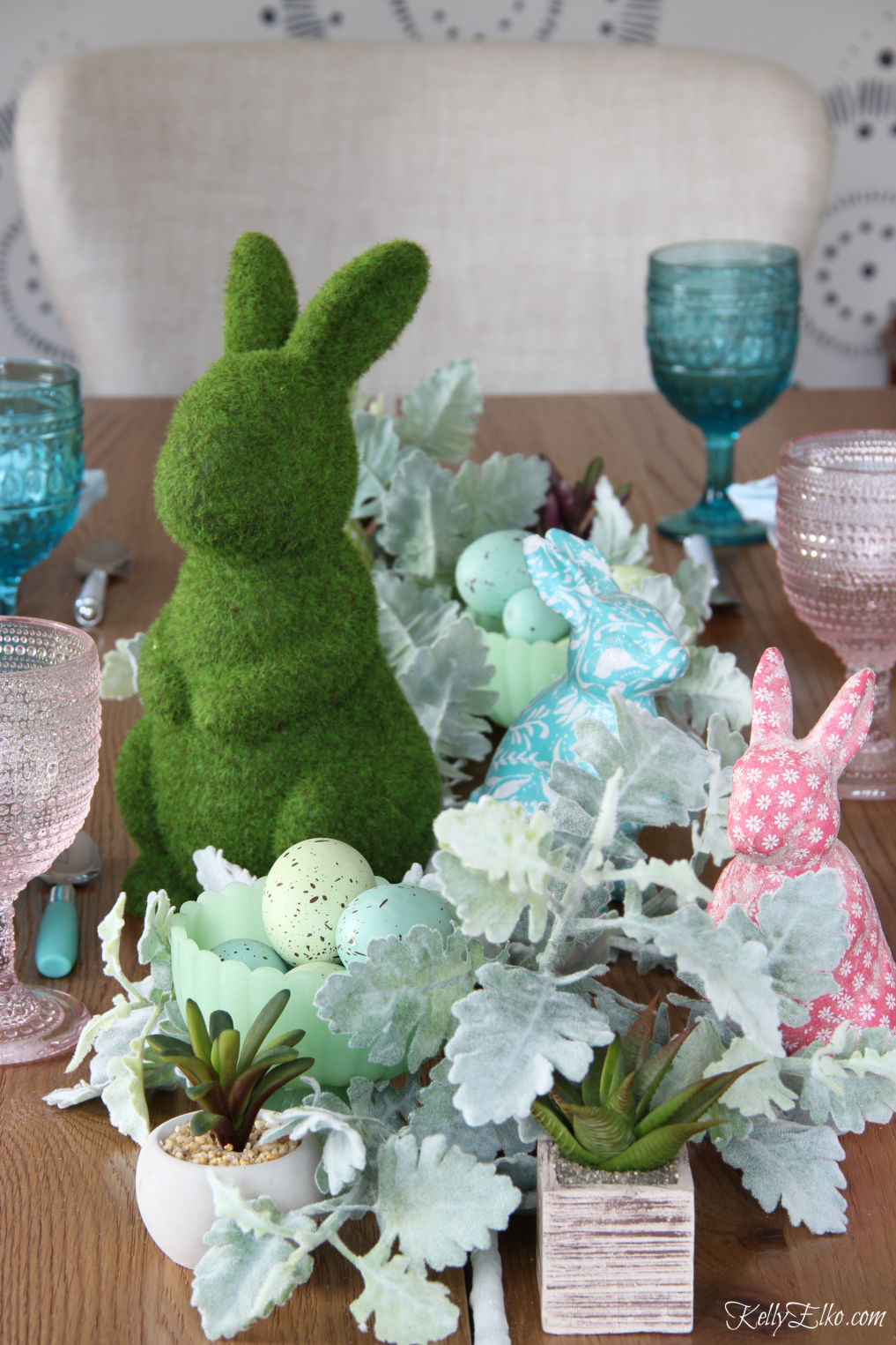 Love this cute spring bunny centerpiece with branches, succulents and bunnies kellyelko.com #springdecor #springcenterepiece #springtable #eastertable #eastercenterpiece #easterbunny
