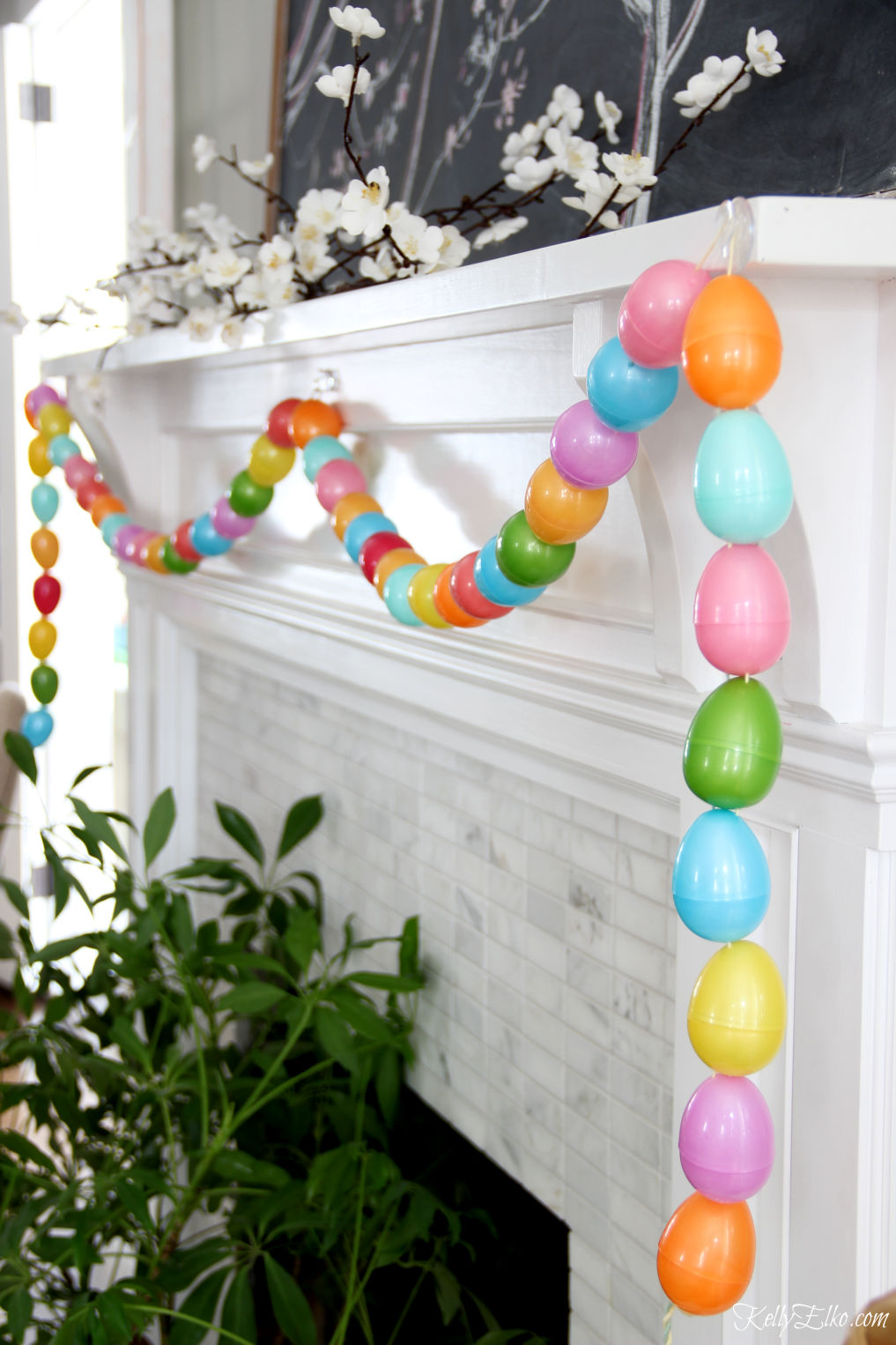 DIY Easter egg garland - love how this look on the spring mantel kellyelko.com #eastereggs #springcrafts #eastercrafts #kidscrafts #mantel #springmantel #manteldecor #crafts #crafting