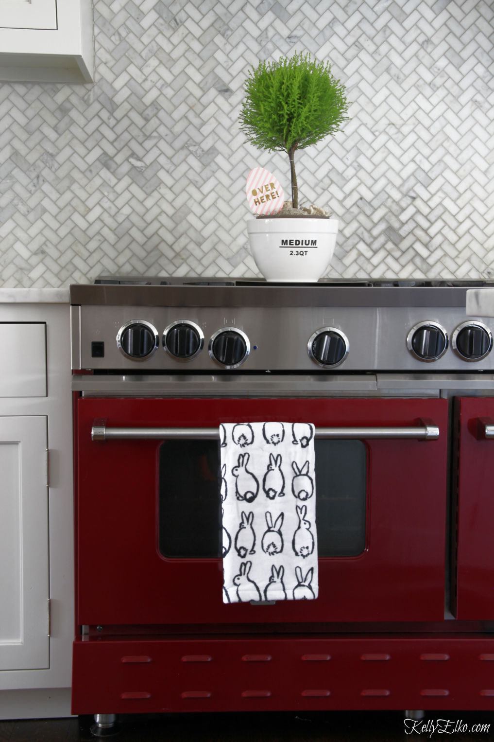 Love this red stove and the marble herringbone tile backsplash kellyelko.com #kitchen #stove #kitchenappliances #appliances #red #whitekitchen #kitchendecor