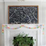 Spring Chalkboard Mantel kellyelko.com #spring #mantel #springdecor #chalkboard #chalkart #livingroomdecor #lighting #plants