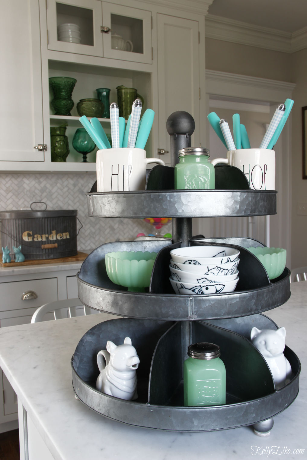 Love this tiered tray for storing everyday kitchen essentials kellyelko.com #farmhousekitchen #whitekitchen #industrialdecor #trays #tieredtray #farmhousedecor #fixerupperstyle #springdecor #jadeite #raedunn #kitchendecor #kellyelko