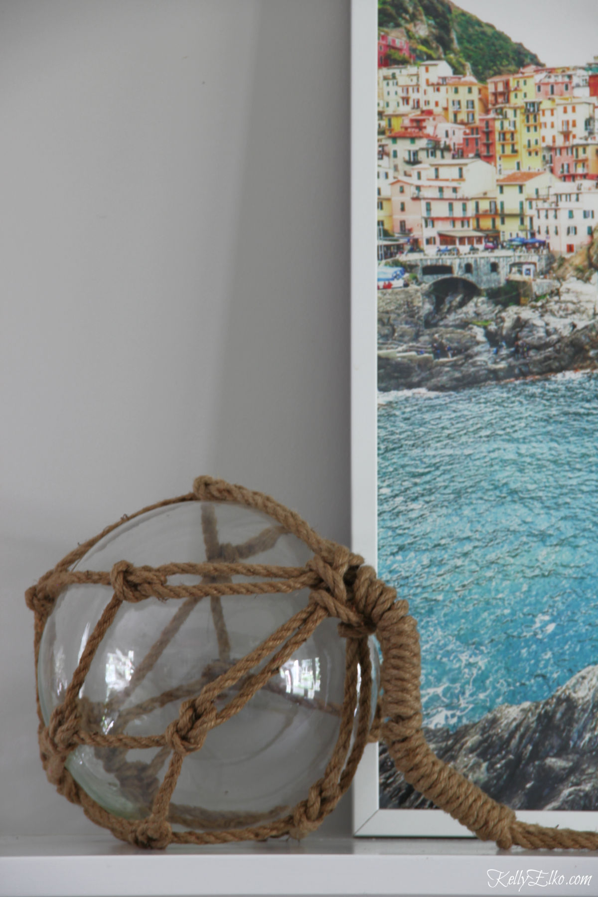Love this jute wrapped buoy on this coastal summer mantel kellyelko.com #buoy #summer #coastal #coastaldecor