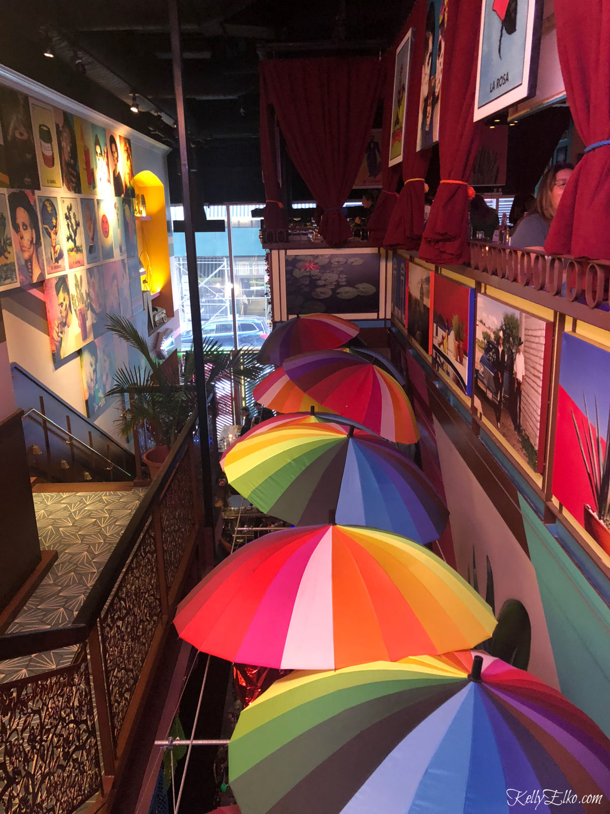 Love the colorful umbrellas in this Mexican restaurant kellyelko.com #colorlovers #colorful