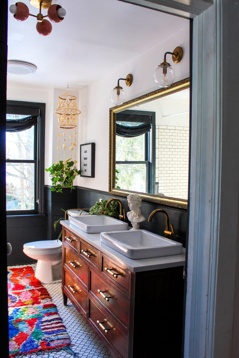 Love this bathroom remodel with repurposed dresser turned vanity and colorful boho accessories kellyelko.com #bathroom #bathroomdecor #bathroomremodel #bohodecor #vintagedecor #lighting #bathroomlighting