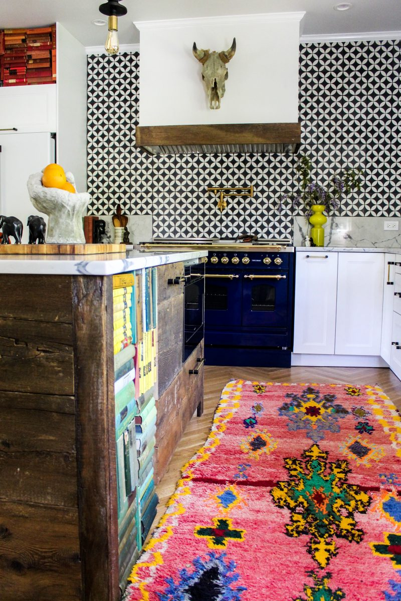 Boho kitchen - love the bold pattern tile backsplash, blue stove and reclaimed wood island kellyelko.com #boho #bohodecor #kitchen #whitekitchen #backsplash #vintagemodern