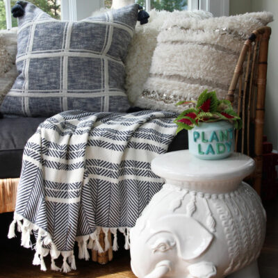 Serena and Lily Sale Picks - love this rattan daybed with blue and white pillows and throws kellyelko.com