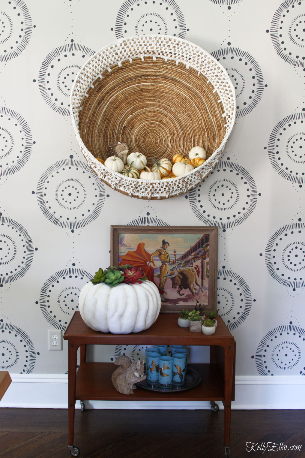 Love this boho wall basket and bar cart styled for fall kellyelko.com #fall #falldecor #pumpkins #pumpkindecor #vintagedecor #barcart #autumndecor #eclecticdecor #bohodecor