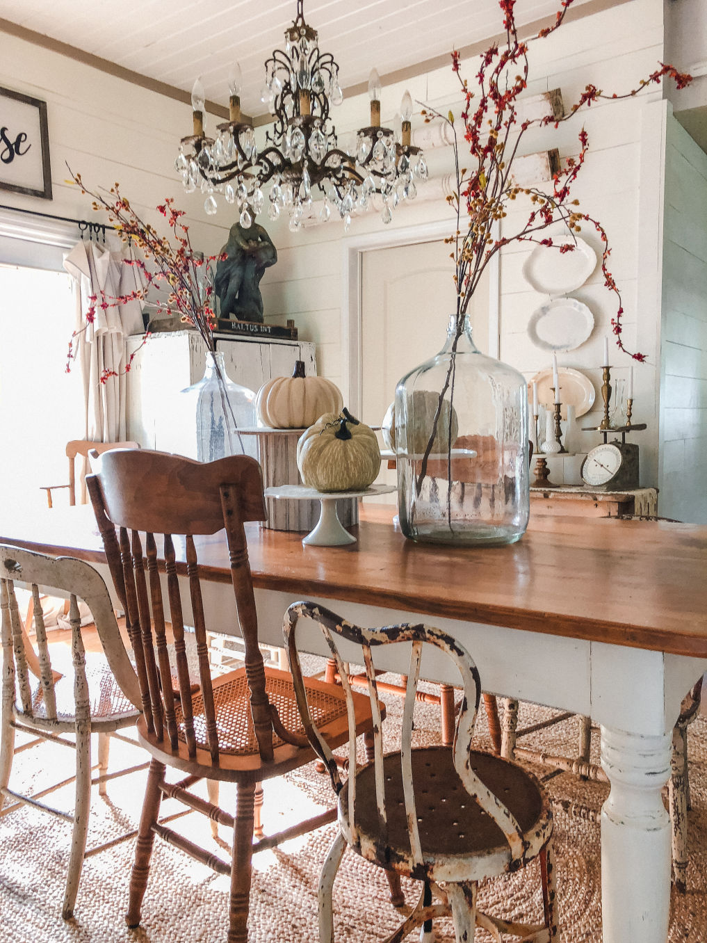 Farmhouse dining room with mismatched vintage chairs and pumpkin centerpiece kellyelko.com #falldecor #falldecorating #diningroom #farmhousediningroom #farmhousedecor #farmhousestyle #centerpiece #shiplap