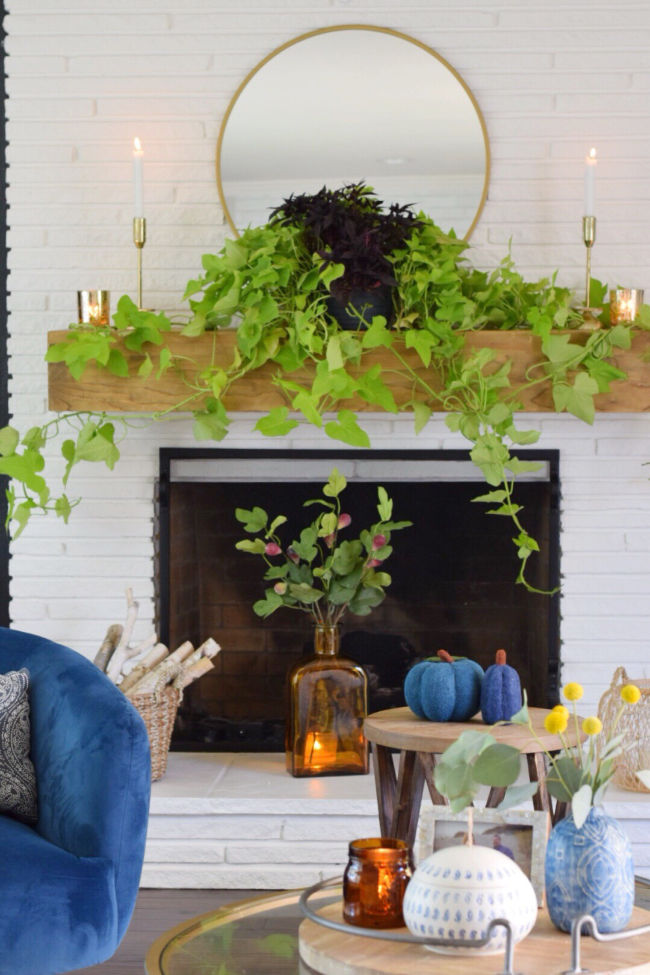 12 Creative Fall Mantels - love this trailing vine hanging from the mantel kellyelko.com #mantel #manteldecor #houseplants #plantlady #falldecor #fallmantel #eclecticstyle