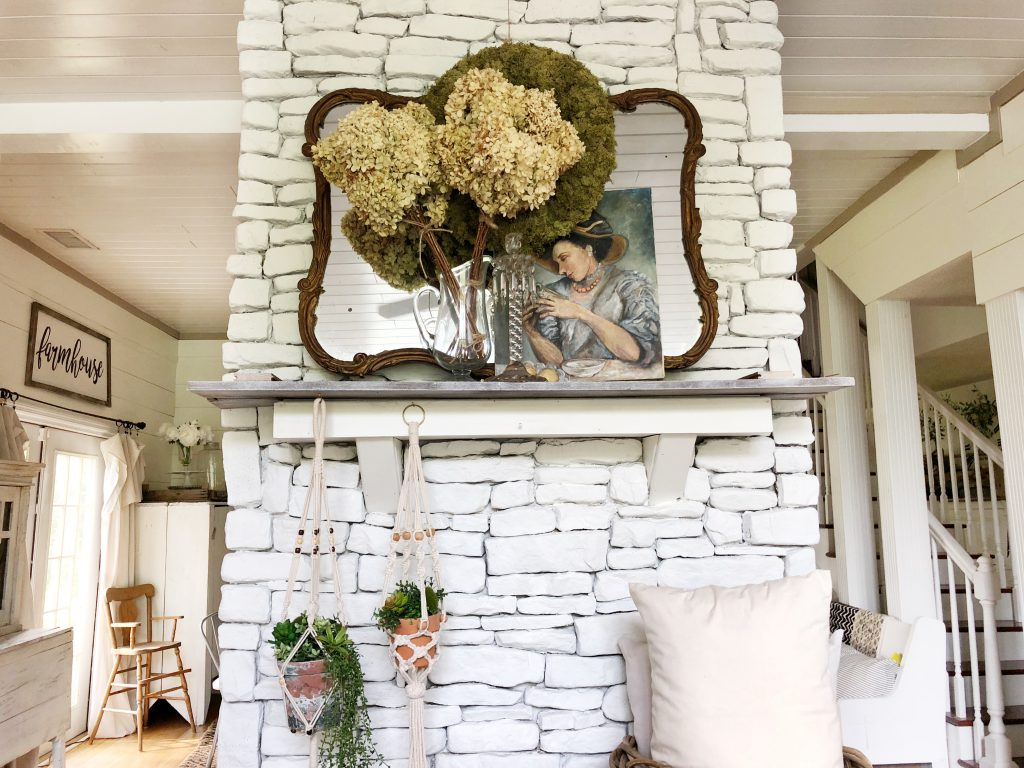 Love this stacked stone fireplace and vintage finds on the mantel kellyelko.com #fireplace #farmhousefireplace #stackedstone #rusticdecor #vintagedecor #farmhousedecor #farmhousestyle #neutraldecor