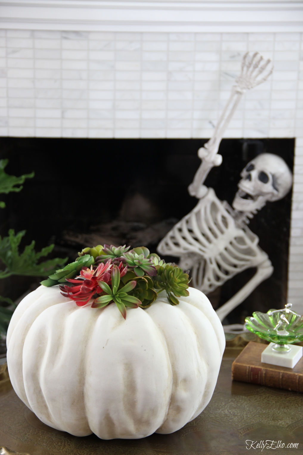 Love this Halloween home and the succulent pumpkin kellyelko.com #halloween #halloweendecor #halloweendecorations #skeleton #pumpkindecor #succulents