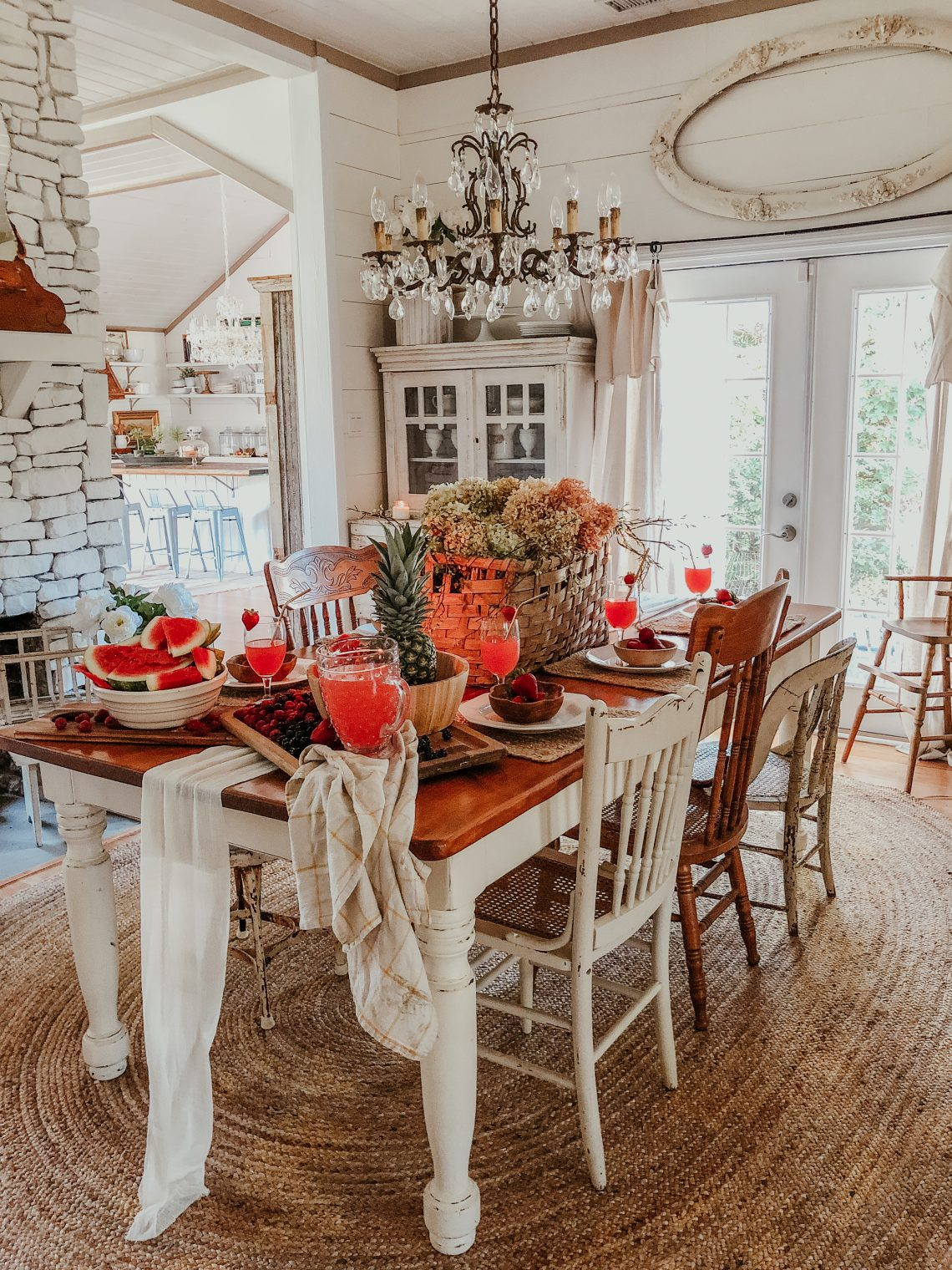 Beautiful farmhouse dining room with mismatched old chairs and crystal chandelier kellyelko.com #diningroom #diningroomdecor #vintagedecor #farmhousedecor #farmhousestyle #neutraldecor #shiplap