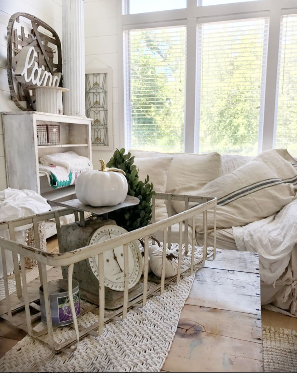 Beautiful neutral farmhouse - love the rusty old scale in a metal basket kellyelko.com #fall #falldecor #falldecorating #farmhousedecor #vintagedecor #neutraldecor #farmhousestyle