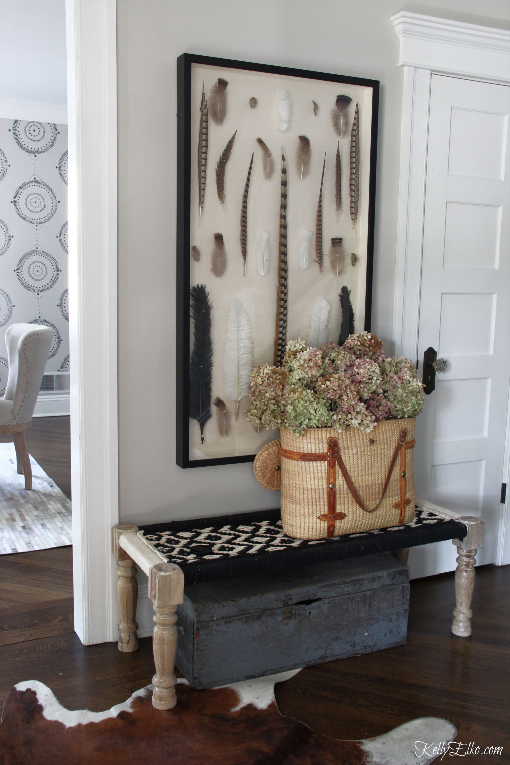 Love this foyer with huge feather art and basket of dried hydrangeas kellyelko.com #foyer #fallfoyer #entrydecor #hydrangeas #vintagedecor #falldecor