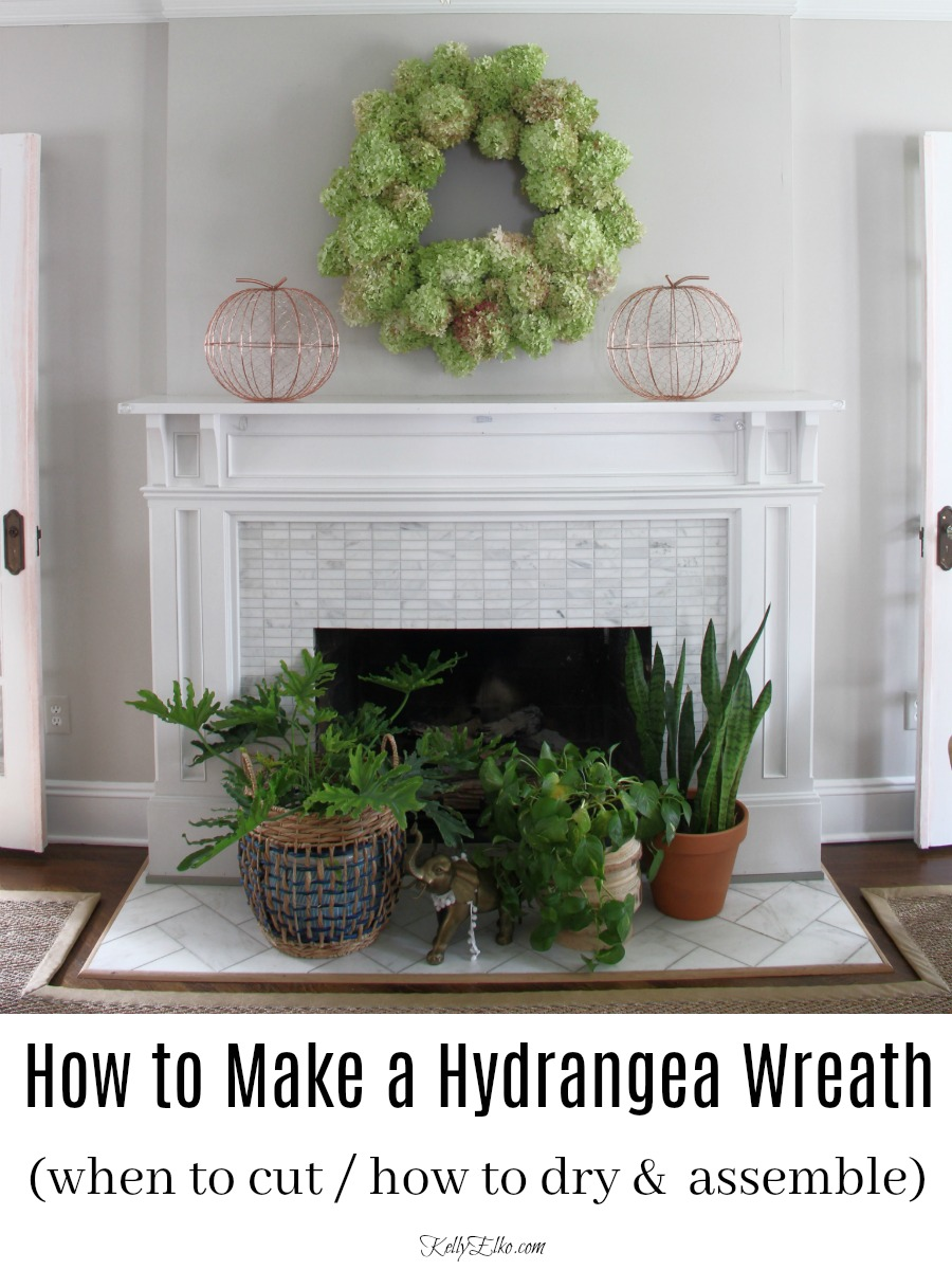 Learn how to make a hydrangea wreath - this one is HUGE and she shares the easiest way to make one! kellyelko.com #wreath #diywreath #wreaths #hydrangeas #hydrangeacrafts #crafts #diyideas #fall #falldecor #fallmantel #plants #houseplants #eclecticdecor #fallmantel #fallfireplace