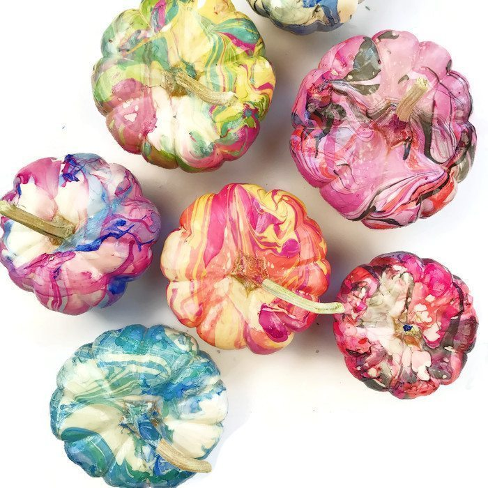 12 DIY Painted Pumpkins - step by step tutorial to create your own marbled pumpkin kellyelko.com #pumpkins #pumpkincrafts #paintingtutorials #paintingtips #fallcrafts #crafting