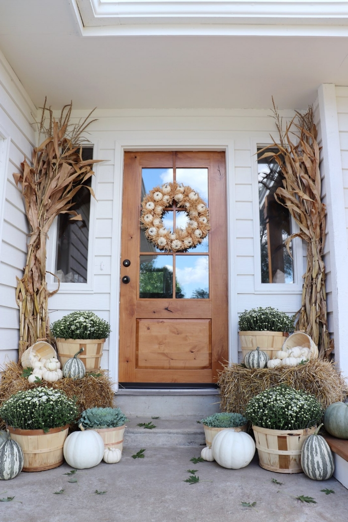 10 Beautiful Fall Porches - love the white mums and pumpkins for a neutral fall look kellyelko.com #fall #fallporch #falldecor #falldecorating #mums #pumpkins #fairylights #porch #frontporch #curbappeal #autummdecor #autummporch #neutralfall