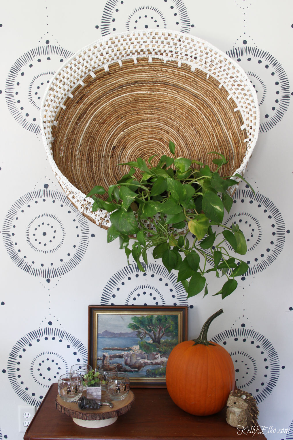 Bar Cart Styling - three different looks! Love the huge wall basket filled with a plant for fall and the vintage finds kellyelko.com #barcart #bohodecor #eclecticdecor #homedecor #falldecor #falldecorating #pumpkins #vintagdecor #plants #planter