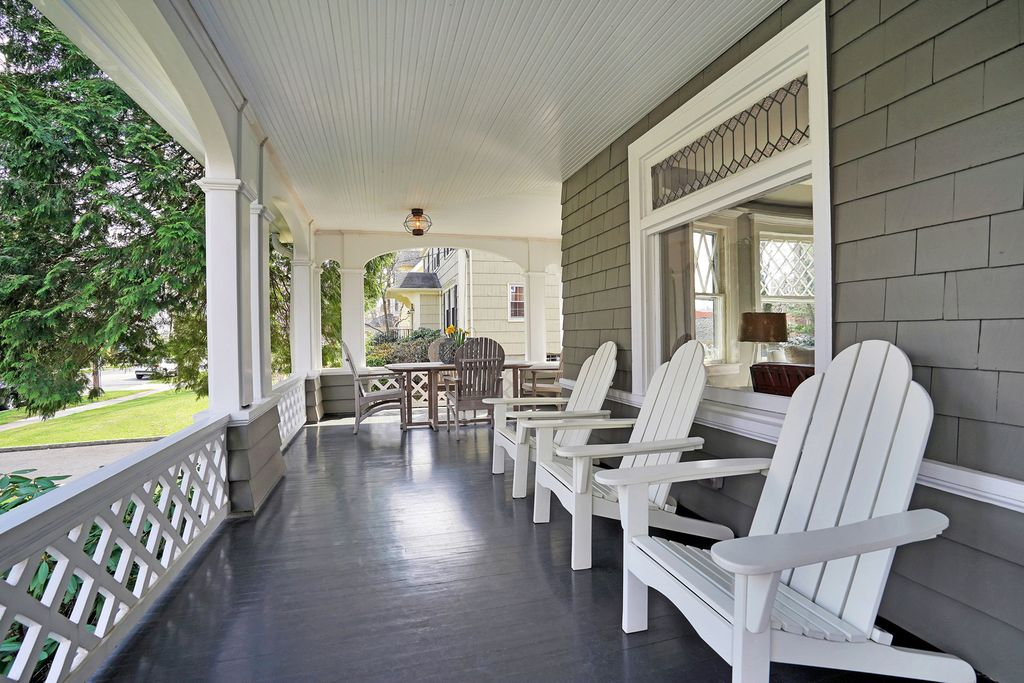 Tour this 1900 home painted gray with beautiful wrap around porch kellyelko.com #porch #frontporch #oldhouse #oldhome #curbappeal #outdoordecor #interiordesign #interiordecor #hometour