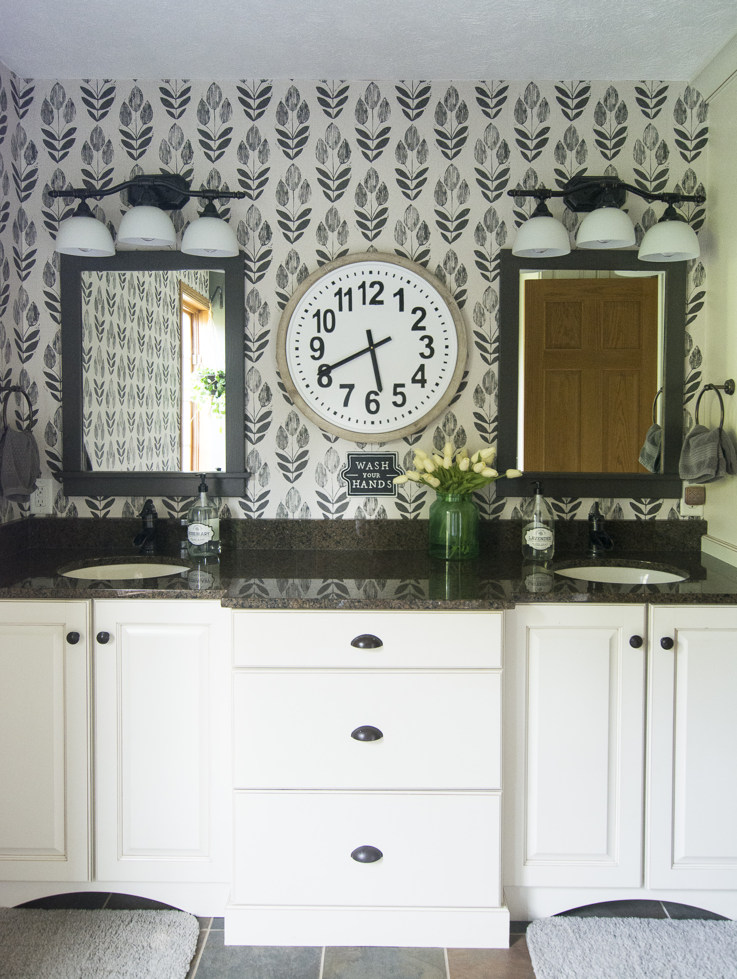 Black and white wallpaper is a statement in this bathroom kellyelko.com #bathroom #wallpaper #bathroomdecor #bathroomreno #interiordesign #blackandwhitedecor