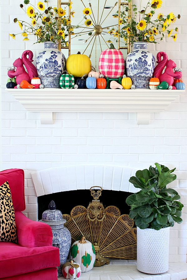 12 Creative Fall Mantels - this colorful fall mantel is so fun with hand painted pumpkins kellyelko.com #fall #falldecor #fallmantel #falldecorating #colorfulfall #colorlovers #mantel #manteldecor #paintedpumpkins #pumpkincrafts